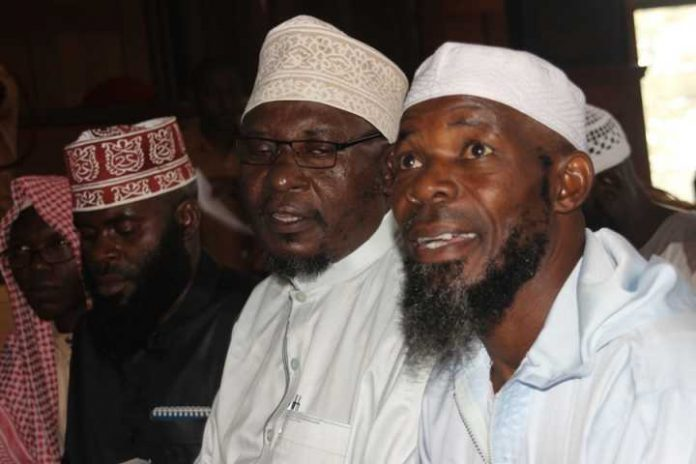 Sheikh Mohammad Yunus Kamoga sitting middle with co accused.