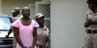 Opposition figure Victoire Ingabire, being led to prison by guards