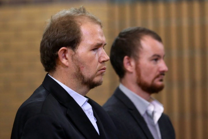Two white S  African farmers jailed for murder of a black