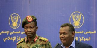 Lieutenant General Shamseddine Kabbashi and protest leader Madani Abbas Madani