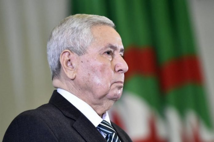 Algeria's interim president calls for dialogue to prepare new elections