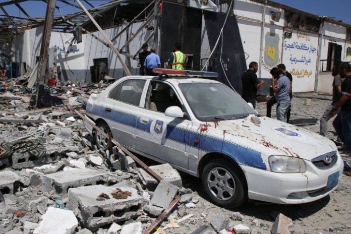 U.N. says Libyan guards shot at migrants fleeing air strikes