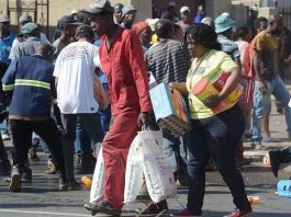 South Africans loot foreigners shops in Soweto