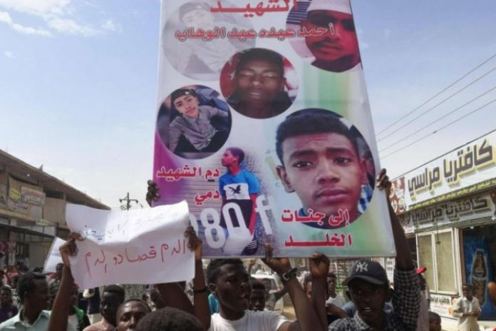 Sudan army commander says security force at a bank killed protesting children