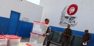 Tunisians vote in tightly contested presidential election